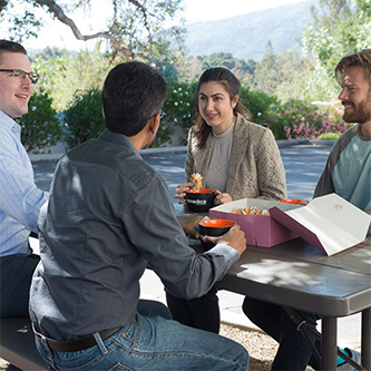 Ximedica Los Gatos employees enjoying coffee outside in the office courtyard
