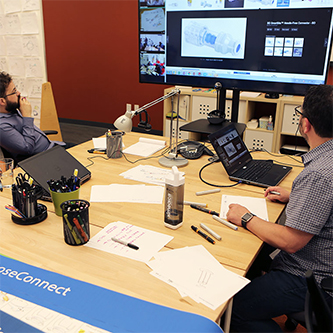 Ximedica Minneapolis employees designing prototype for a medical device